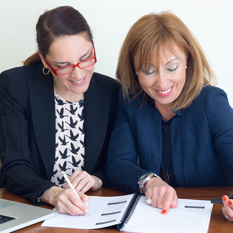 female colleagues reviewing papers